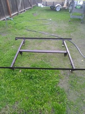 Metal bed frame folds and has wheels for a full size mattress for Sale in Modesto, CA