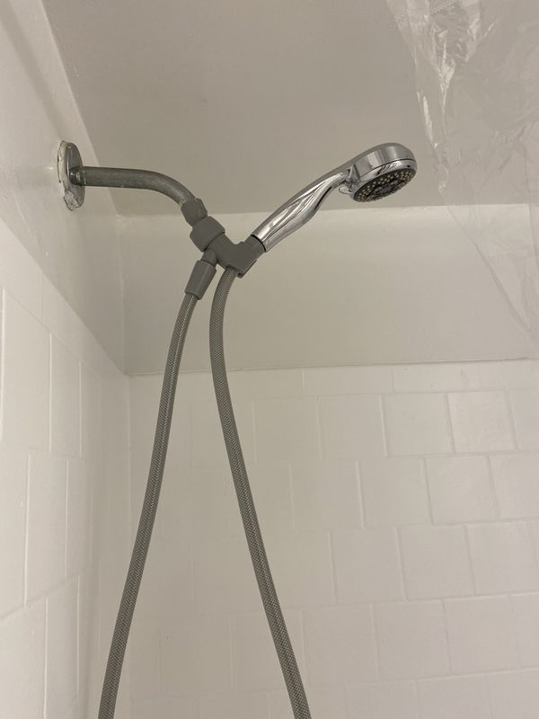 Shower head + shower curtain + 2 memory foam black rugs.