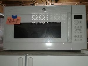 Brand new GE over the range microwave available in black and stainless steel for Sale in Baltimore, MD