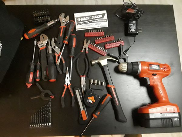 Black and Decker tool kit with travel bag. Includes and 18V power drill with power cord. Lightly used.