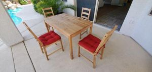 Ikea JOKKMOKK table, Brown with Red Chair cushion. for Sale in Las Vegas, NV
