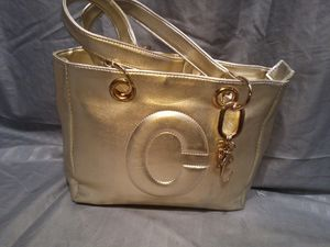 "Gold ""C"" Bag W/ Charm for Sale in Duluth, GA"