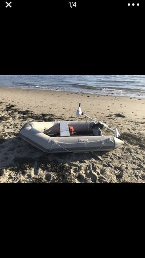 Inflatable boat dinghy with minn Kota motor and battery for Sale in Portland, OR