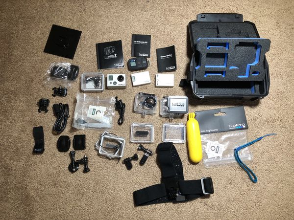 GoPro Hero 2 with accessories and waterproof storage case