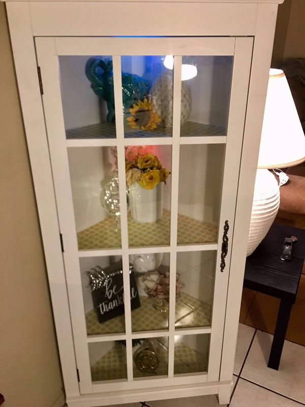 Corner Curio Display Cabinet With Adjustable Shelving To Provide Ample Storage