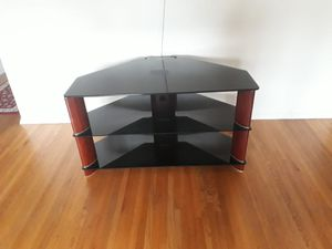 brown wooden frame glass top TV stand for Sale in Manassas Park, VA