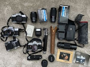 Vintage Camera bundle (Canon AE1 and 3 Minolta cameras, and lenses, and cases) for Sale in La Verne, CA