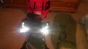 One extra large Marlboro backpack , one green backpack, one green athletic bag, large army duffle bag . for Sale in Lakewood, WA