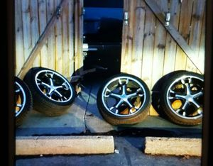 20 inch rims and tires 5 lug machined and black for Sale in Mission, KS