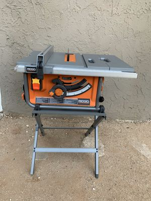 RIDGID 15 Amp Corded 10 in. Compact Table Saw with Carbide Tipped Blade and Folding X-Stand for Sale in Long Beach, CA