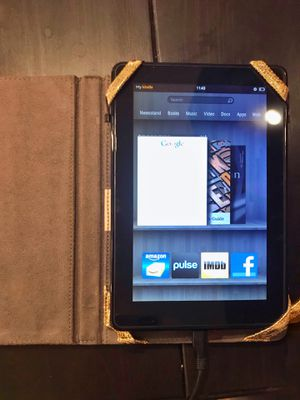 Kindle Fire 2014 w/metallic gold case and charger for Sale in Coronado, CA