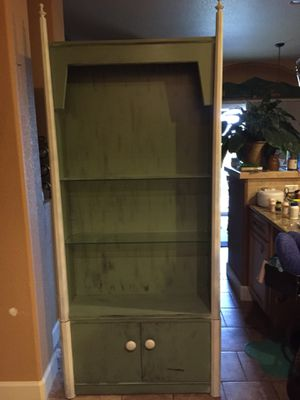 Green and white wood shelving unit for Sale in Fountain, CO
