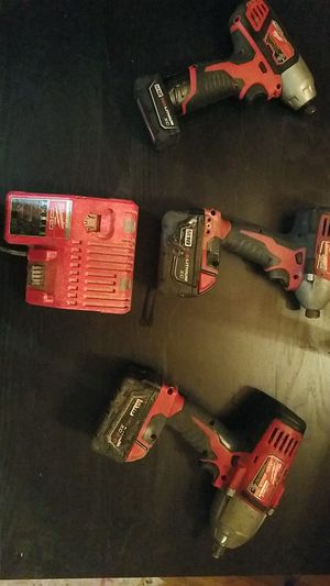 Milwaukee 2 impact driver and 1 1/2 impact wrench with charger for Sale in Seattle, WA