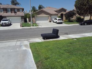 Futon out on curb! Black color in good shape for free for Sale in Corona, CA
