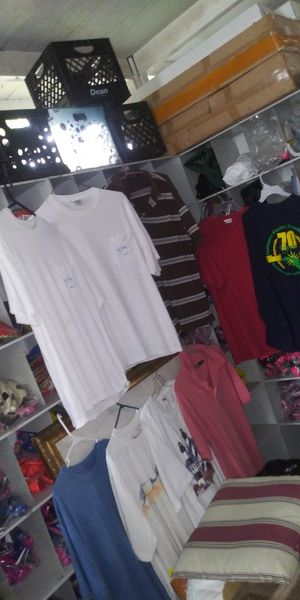 Alot of men clothes all for Sale in Lake Worth, FL