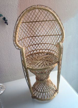 Wicker peacock chair plant holder for Sale in Portland, OR