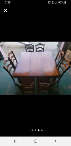Solid wood table/8 chairs folding center piece for Sale in Long Beach, CA