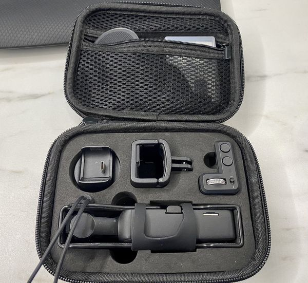 DJI Osmo pocket with case expansion kit. Wireless connectivity gimbal wheel go pro mount