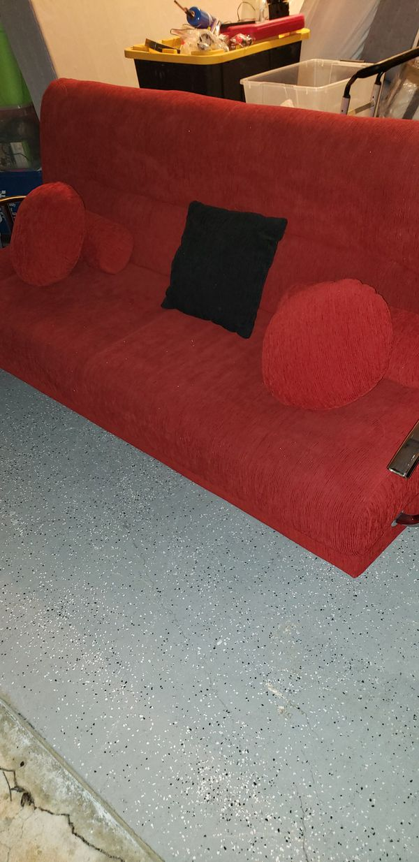 Red futon/ couch with storage underneath