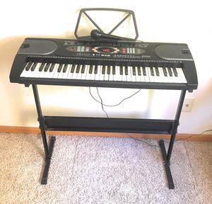 61 Key Electric Black Keyboard Digital Piano 128 Rhythms With Microphone Like New for Sale in Lincoln, NE