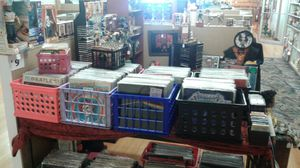Records and collectable glasses cds and cassette tapes books toy for Sale in St. Louis, MO