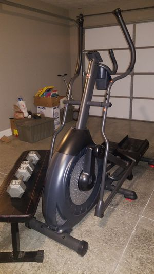 Elliptical and weight bench with 2 dumbells. for Sale in Richmond, KY