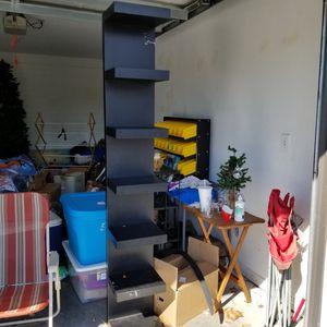 Tall black shelf/bookcase for Sale in Palm Harbor, FL