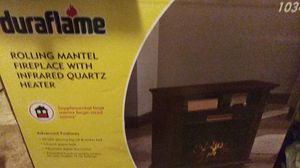 Duraflame rolling mantel fireplace with infrared quartz heater for Sale in Tacoma, WA