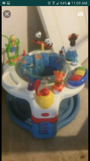 Baby swing , exersaucer , door hanging jumper oo, walking toy. 60 takes all . for Sale in Cleveland, OH