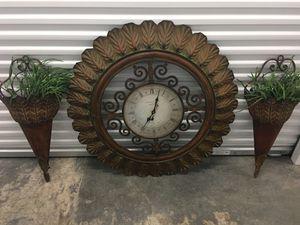 Wall metal clock and flower hangers for Sale in Ocoee, FL