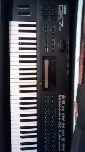Dx7 professional keyboard with samplers. Bag and peddle for Sale in Wenatchee, WA