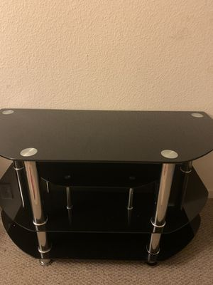 Black glass tv stand for Sale in Oakland, CA