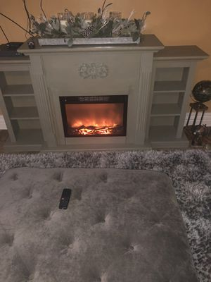 electric fireplace With bookshelves It's still new just don't like the color for Sale in New Orleans, LA