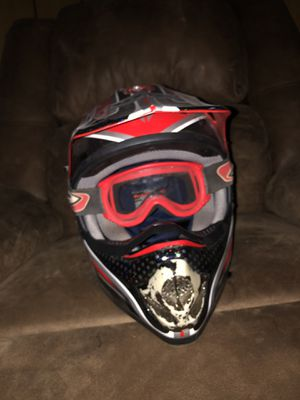 Dirt bike helmets blue one is medium red one is small for Sale in Pollock, LA