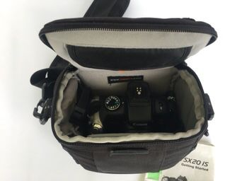 Canon Power Shot SX20 IS with camera case and SDHC card