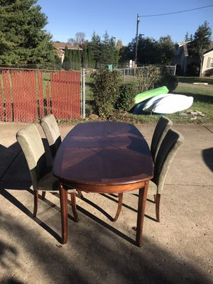 Dining room table and 4 chairs and armoire cabinet for Sale in Murfreesboro, TN