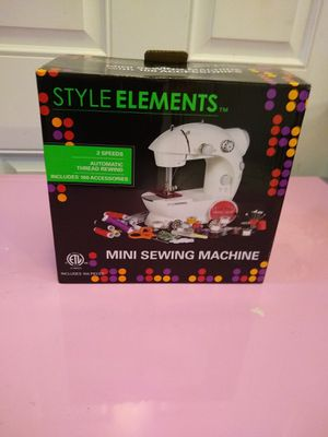 Mini sewing machine with 100 acessories for Sale in Lakeland, FL