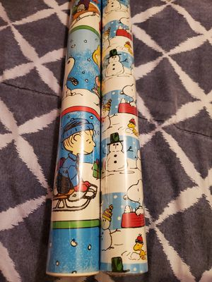 2 Rolls Of Peanuts Christmas Wrapping Paper for Sale in Lakeland, FL