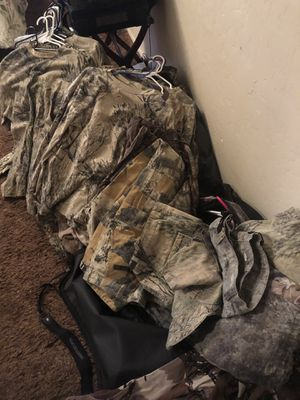 Camouflage hunting clothes and large Rocky duffle bag mostly Cabelas brand on clothes for Sale in Litchfield Park, AZ