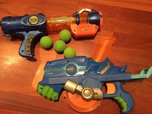 Nerf Reactor and Buzzsaw Guns plus Four Green Nerf Balls for Sale in Portland, OR