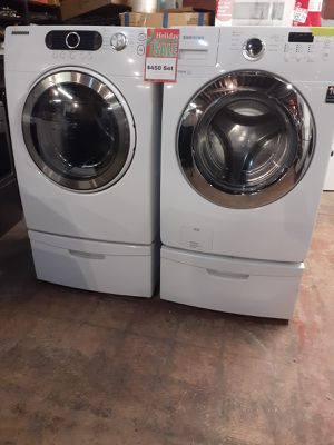 Samsung front load washer and dryer set with pedestal working perfectly with 4 months warranty for Sale in Baltimore, MD