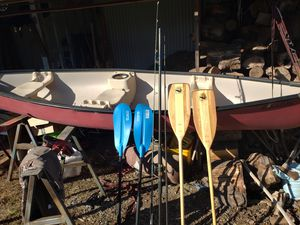 Old town canoe fishing poles paddles oars and tow dolly 300 bucks for Sale in Gresham, OR