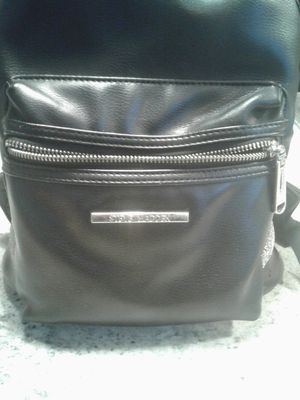 Black Leather and Silver Steve Madden Lil Book again and Steve Madden wristlet for Sale in Pittsburgh, PA