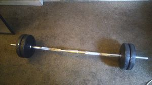 Curl bar + weights for Sale in East Compton, CA