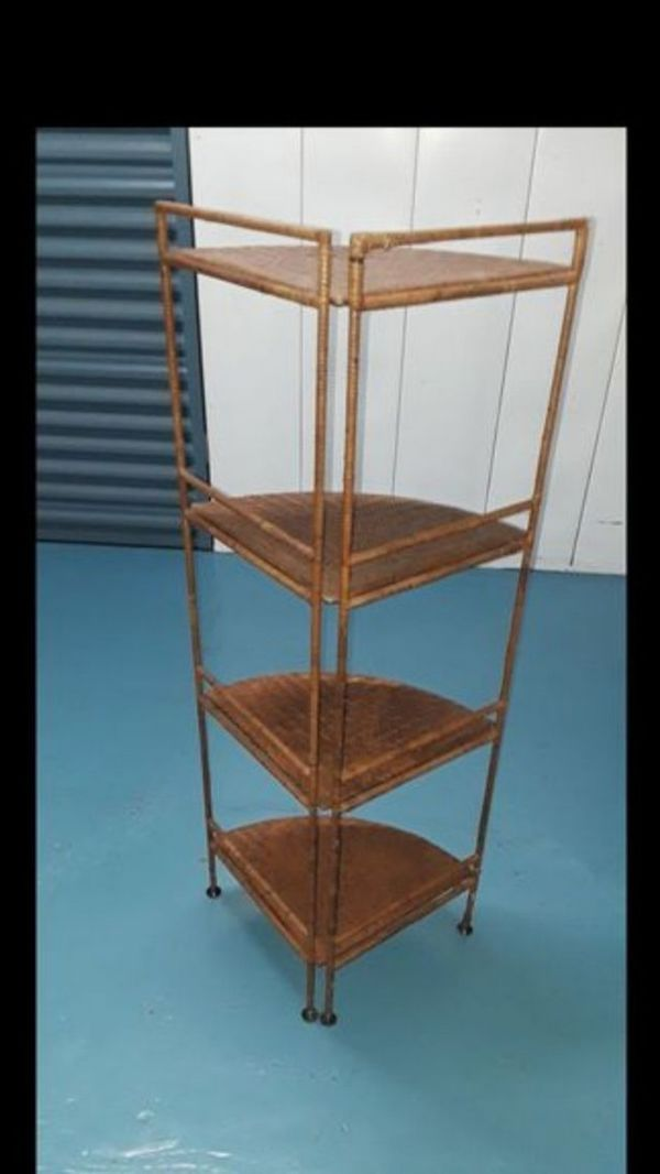 Beautiful wicker wrapped around a metal frame. Four tier shelving corner unit