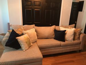 Sectional couch with decorative pillows for Sale in The Bronx, NY