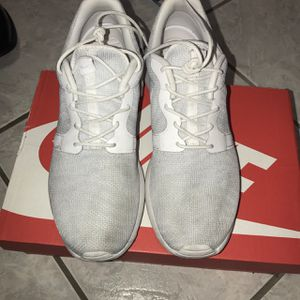 All white nike running shoes $25 size 9.5 for Sale in Miami, FL