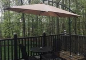 Outdoor umbrella and fire pit table for Sale in Alexandria, VA