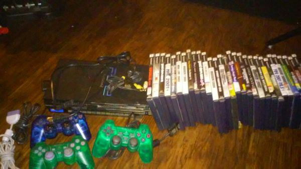 Playstation 2 with controllers and games
