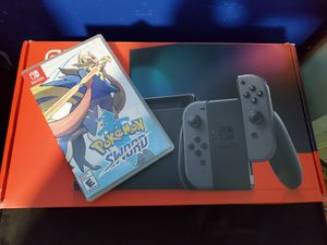 Nintendo switch whit pokemon sword , price firm, all cords , dock etc. for Sale in San Diego, CA